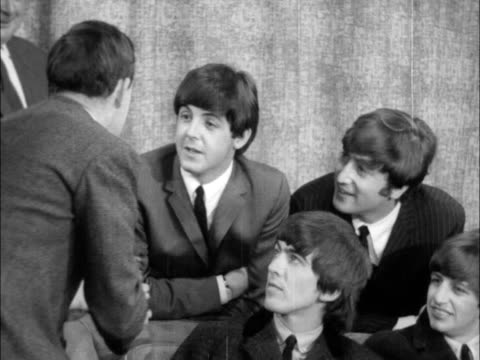Beatles at press conference in London