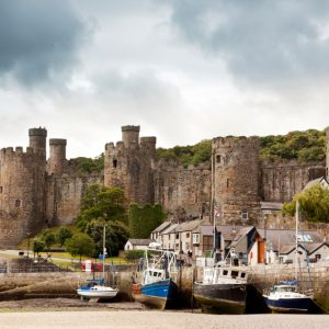 Conwy Castle and harbor at ebb-tide